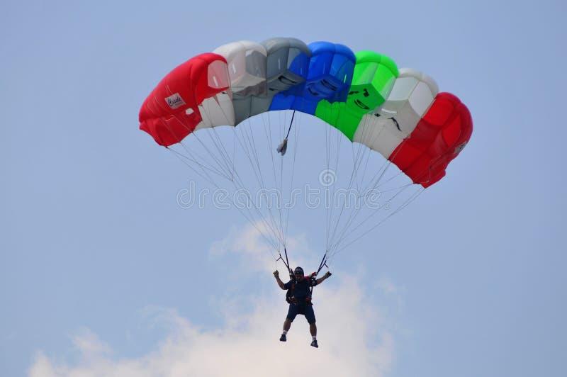 Preparation of World Military Parachuting Championship. Parachuting athletes practice at Manahan Stadium, Surakarta, Indonesia. Indonesia will hold World royalty free stock images