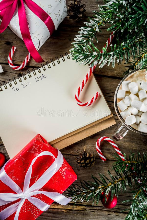 Preparation for xmas holidays. Christmas concept, preparation for xmas holidays, notepad for wish list, santa letter. to do list, with hot hot chocolate cup royalty free stock photography