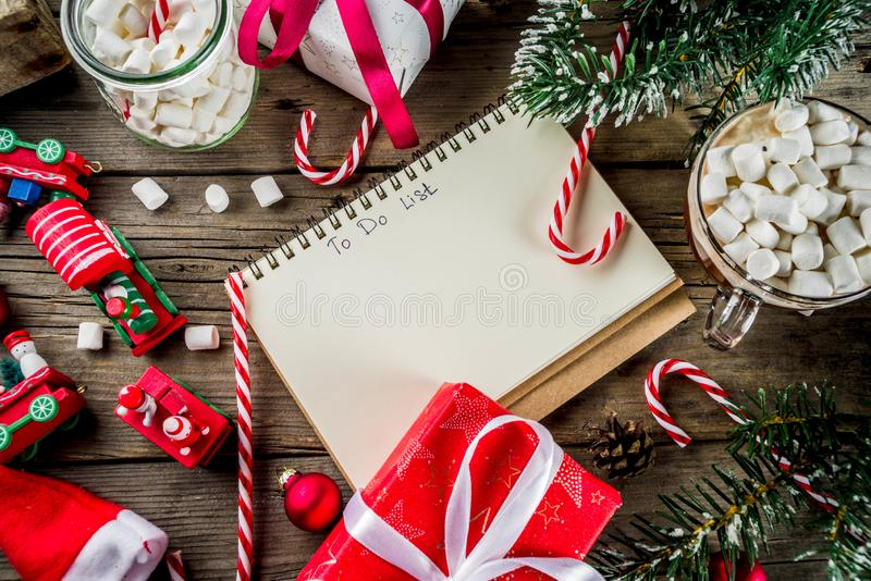 Preparation for xmas holidays. Christmas concept, preparation for xmas holidays, notepad for wish list, santa letter. to do list, with hot hot chocolate cup stock image