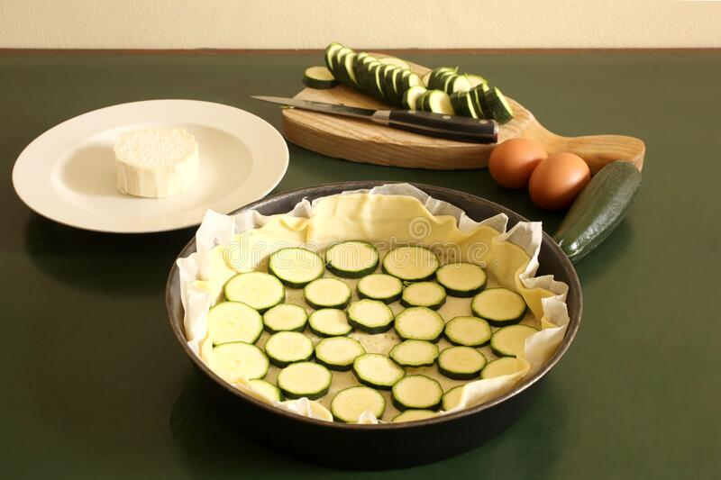 Preparation of a zucchine savory cake with copy space for your text stock photos