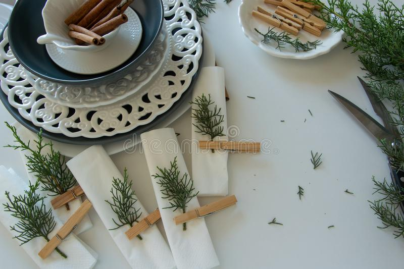 Preparations about arranging the table for winter holidays. Winter decoration royalty free stock images
