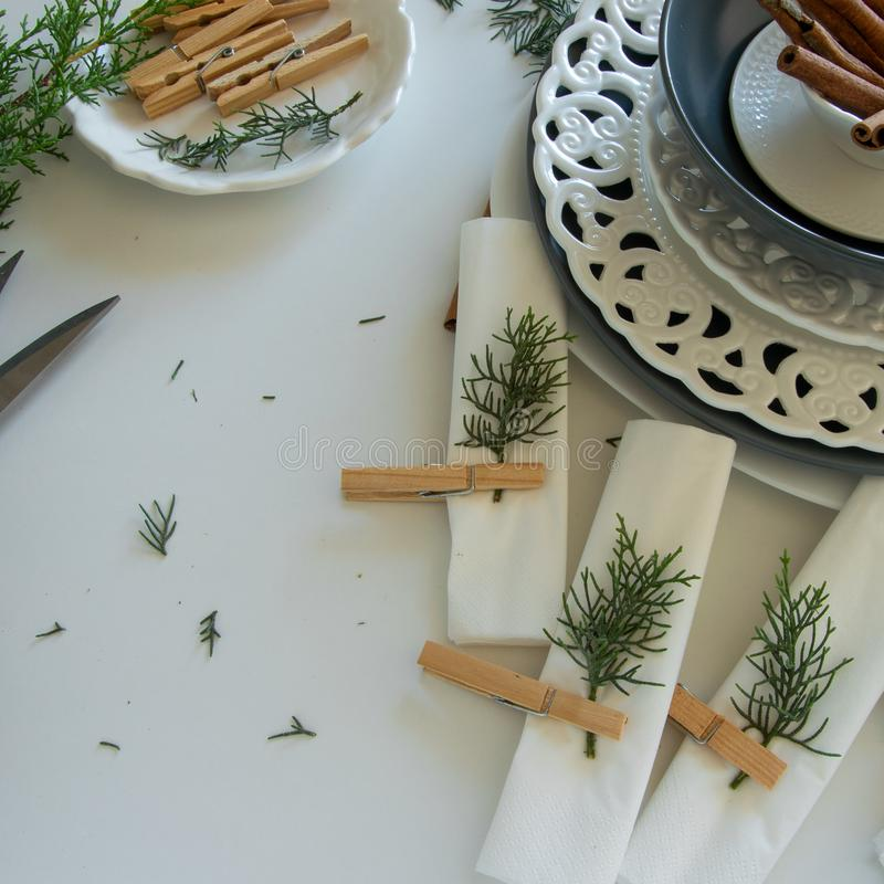 Preparations about arranging the table for winter holidays. Winter decoration stock images