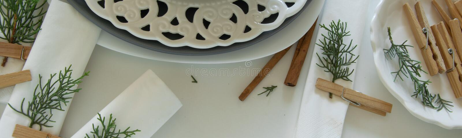 Preparations about arranging the table for winter holidays. Winter decoration stock photo
