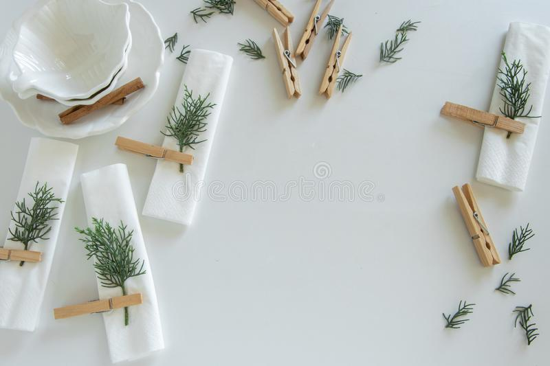 Preparations about arranging the table for winter holidays. Winter decoration stock photography