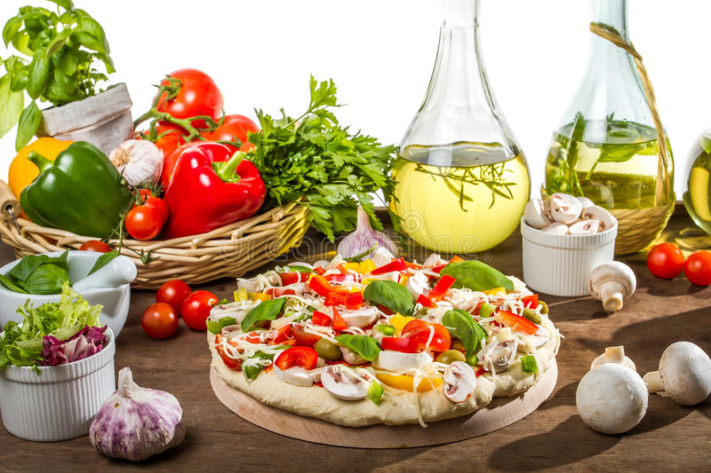 Preparations for baking pizza royalty free stock photos