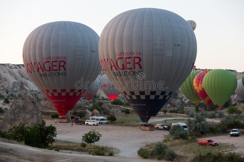 Preparations to the start of the balloon at sunrise. Cappadocia - preparations to the start of the balloon at sunrise royalty free stock photo