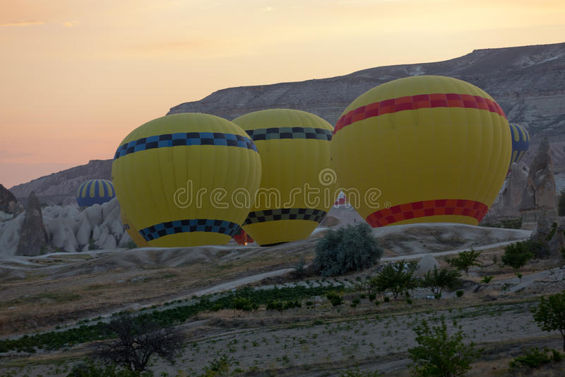 Preparations to the start of the balloon at sunrise. Cappadocia - preparations to the start of the balloon at sunrise stock image