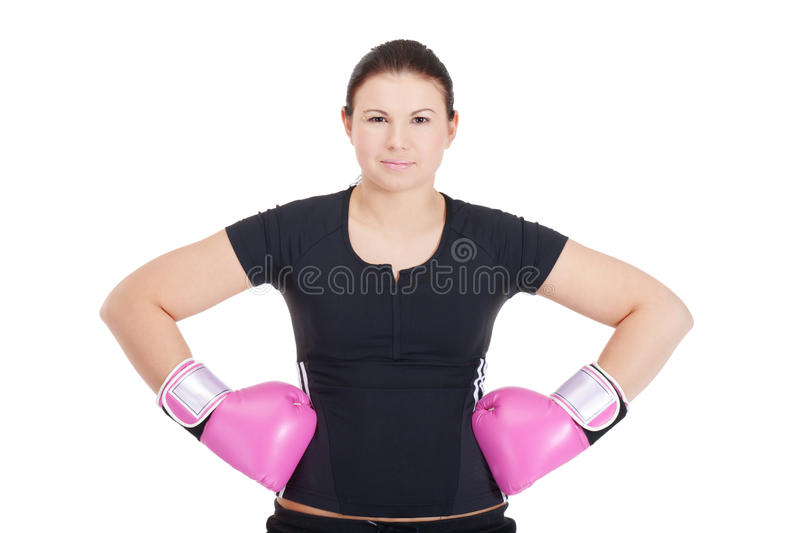 Prepare for the battle. Young athletic-looking girl is preparing for the battle royalty free stock photos