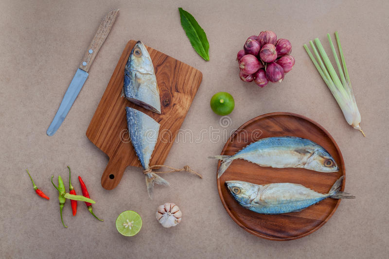 Prepare cooking traditional thai food preserved salted fish salad with chili ,onion,lime, Cilantro ,garlic and lemongrass on brow stock photography
