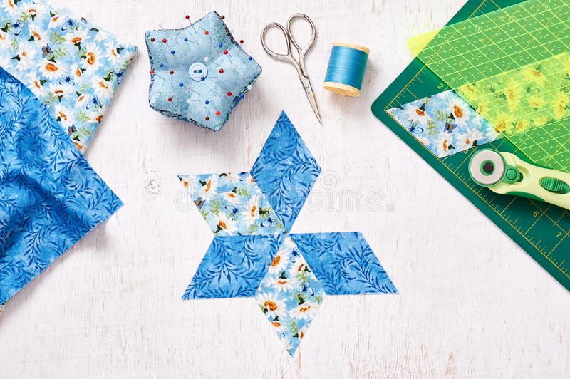Prepare of diamond pieces of fabric for sewing quilt, top view royalty free stock photos
