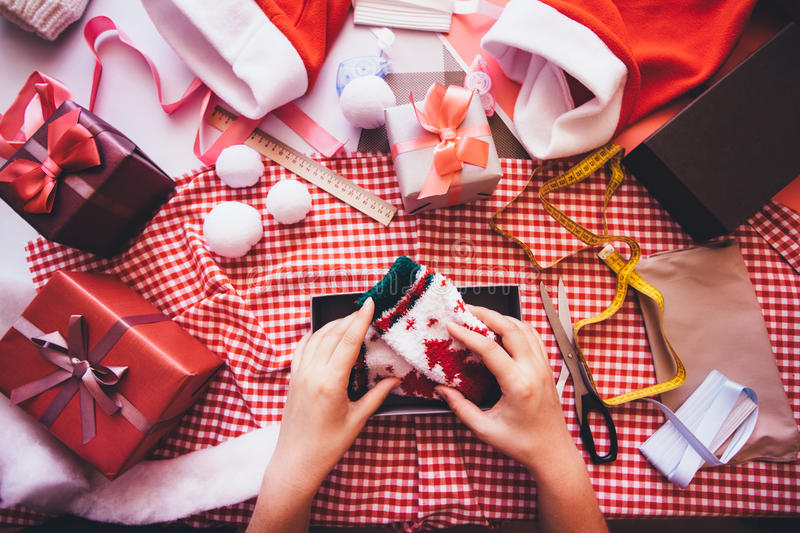 Prepare gifts. Hands of woman decorating Christmas gift box. Prepare gifts royalty free stock photos