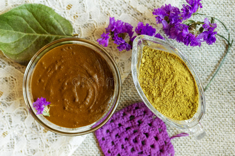 Prepare the henna paste at home. Focus on the powder. Henna powder and henna paste. Prepare the henna paste at home. Focus on the powder royalty free stock photos