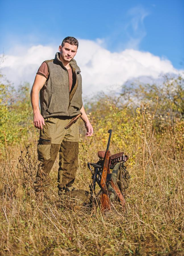 Prepare for hunting. What you should have while hunting nature environment. Man with rifle hunting equipment nature. Background. Make sure safe condition royalty free stock photography