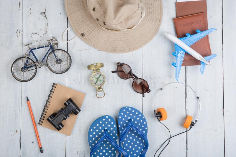 Prepare for journey - accessories and travel items, packing clothes: hat, passport, tickets, model of airplane and bicycle, flip royalty free stock photos