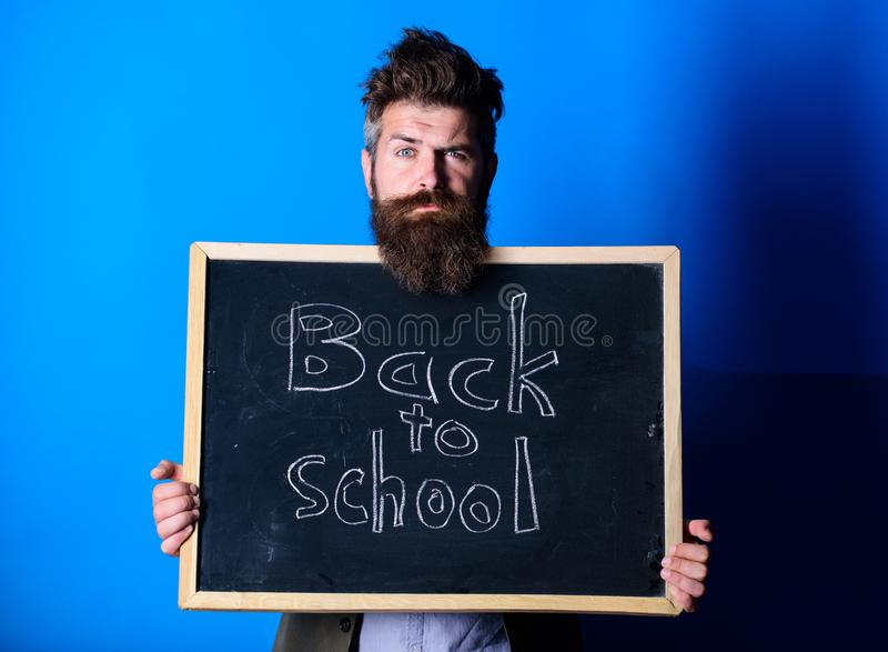 Prepare for new school year. Teacher advertises back to studying, begin school year. Teacher bearded man stands and stock image