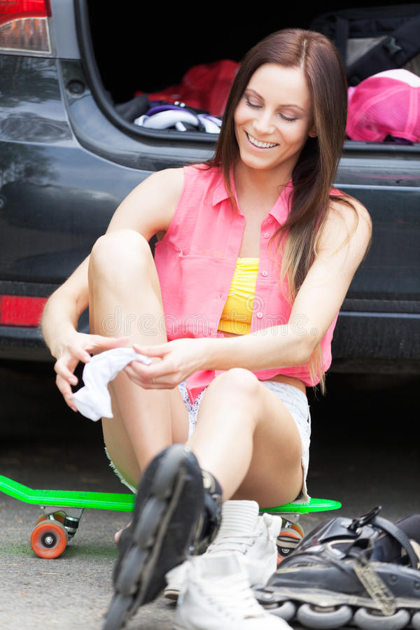 Prepare for a ride. Roller girl preparing for a ride royalty free stock photo