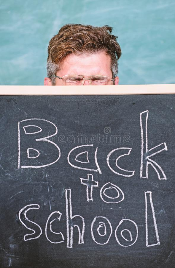 Prepare school year. Are you ready study. Teacher or school principal welcomes inscription back to school. Educator. Hiding behind blackboard. Education royalty free stock photography