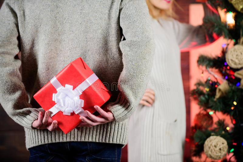 Prepare surprise. Winter surprise. Man carry gift box behind back defocused background. Christmas surprise concept stock images