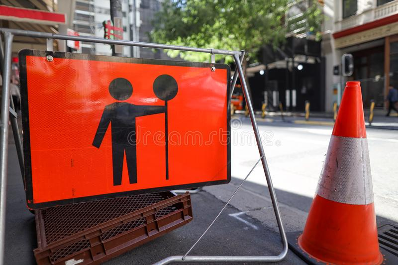 Prepare to stop warning road work ahead symbol sign applying on busy business center royalty free stock image