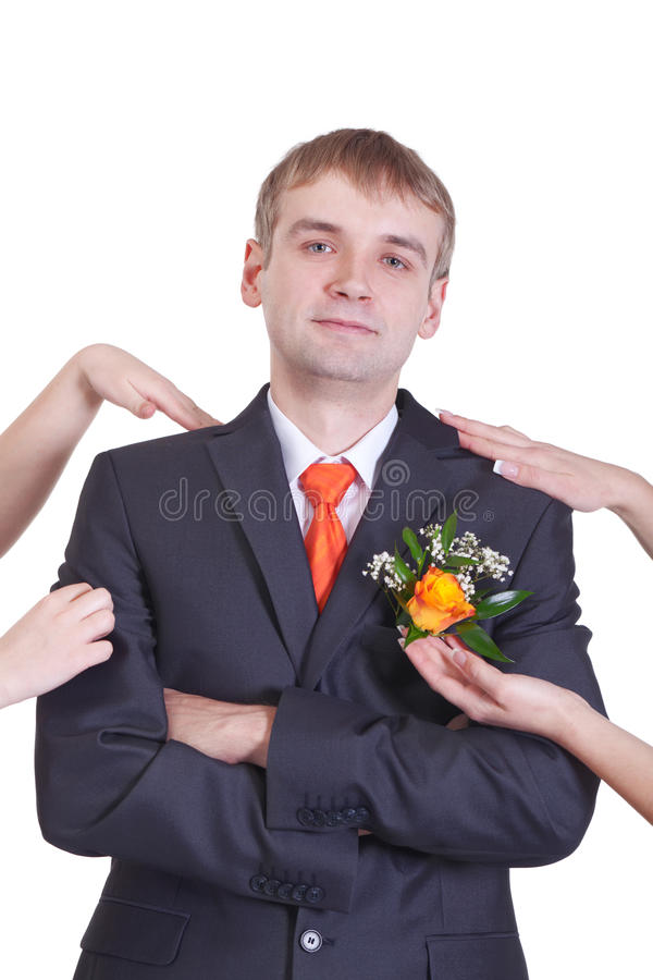 Prepare for the wedding. Groom is prepared by careful hands of girlfriends stock photos