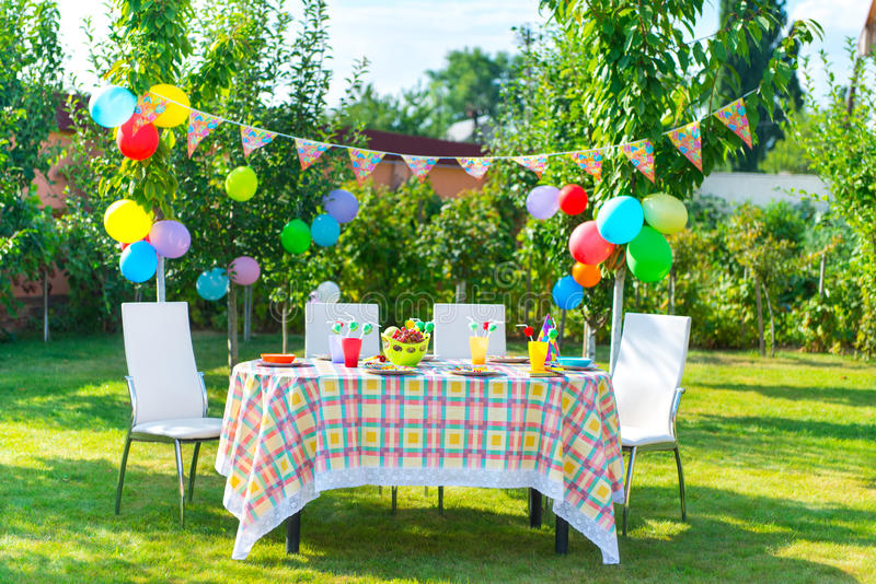 Prepared birthday table. In summer green garden stock images