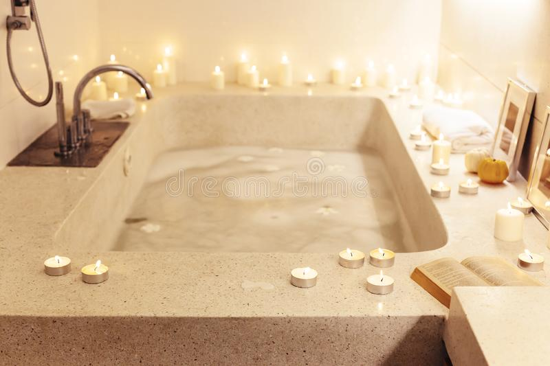 Night spa bath with candles royalty free stock photo