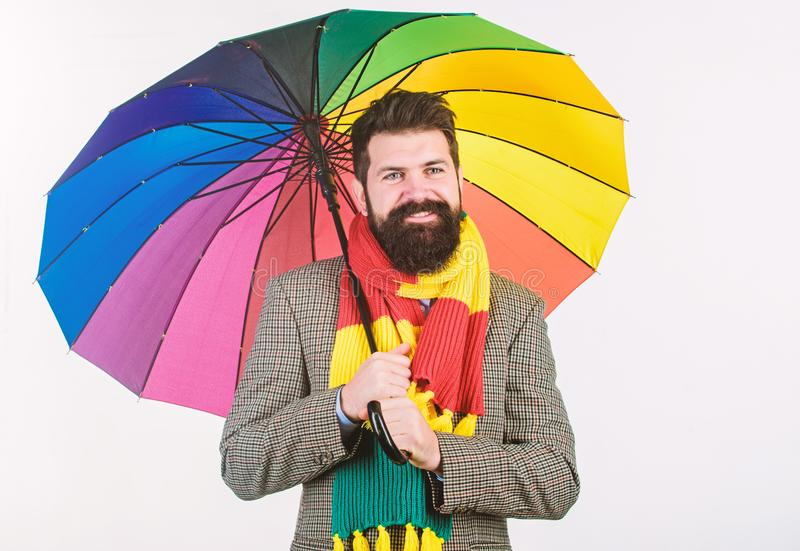 Prepared for rainy day. Carefree and positive. Enjoy rainy day. Seasonal weather forecast. Man bearded hipster hold royalty free stock images