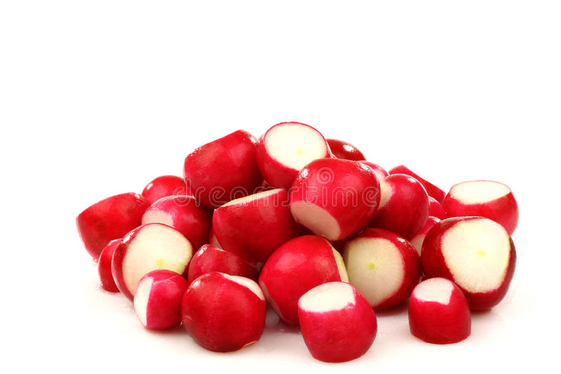 Prepared red radishes. On a white background stock photos