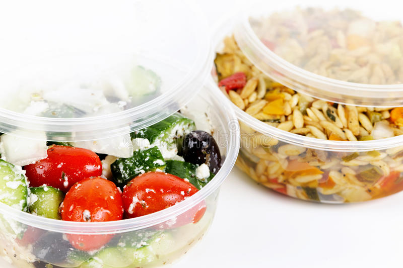 Prepared salads in takeout containers. Two servings of prepared salad in plastic takeaway containers royalty free stock photos