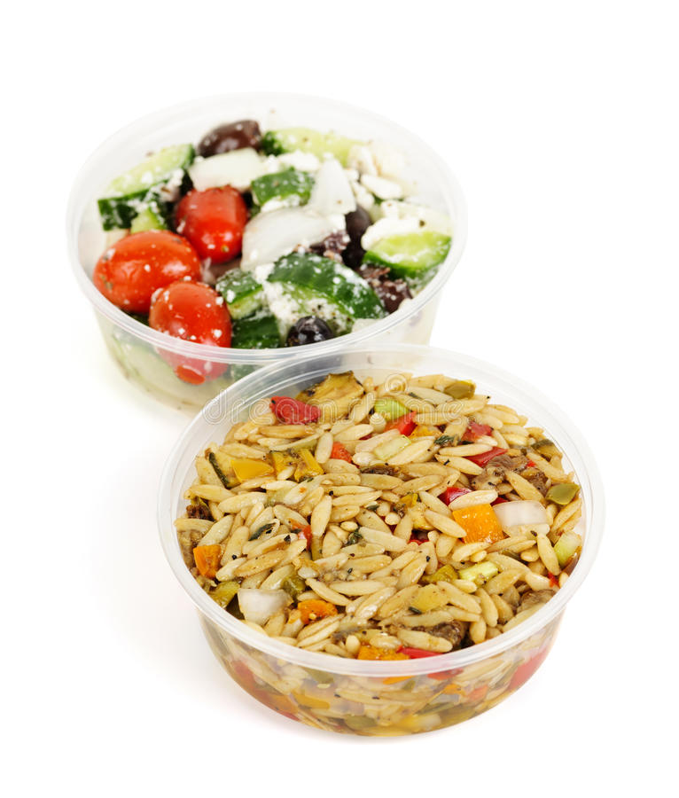 Prepared salads in takeout containers. Two servings of prepared salad in plastic takeaway containers royalty free stock images