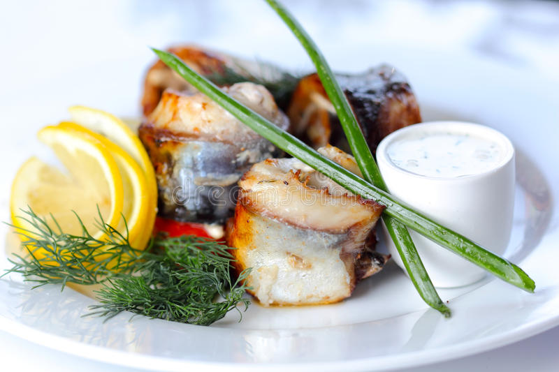 Prepared Sea Fish Portions With Greens Stock Photos