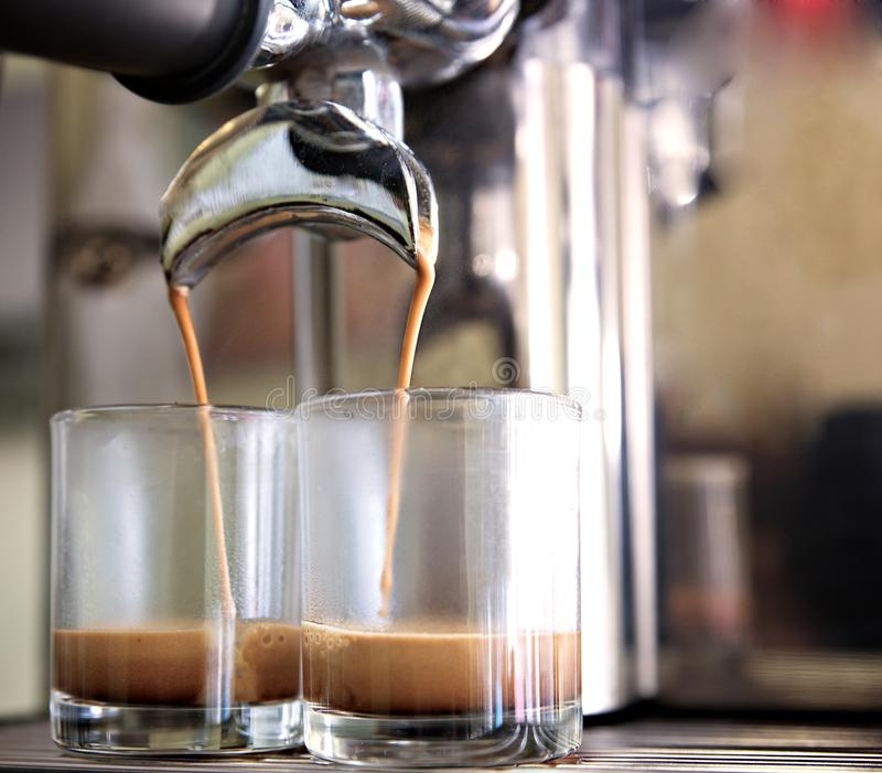 prepares espresso in his coffee shop; close-up stock images