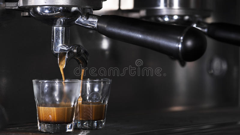 Prepares espresso in his coffee shop. Close-up royalty free stock photography