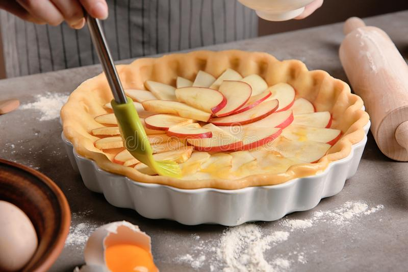 Preparing of apple pie on table royalty free stock photography