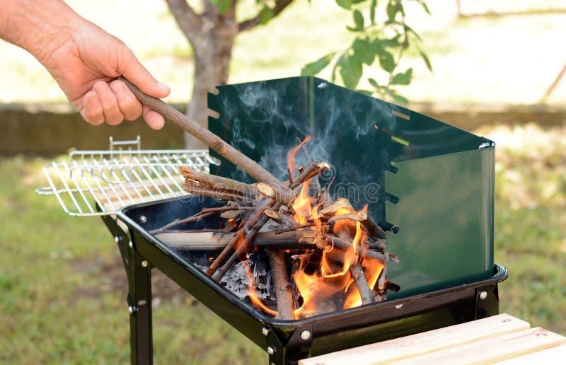 Preparing barbeque stock image