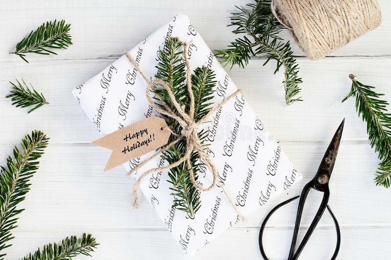 Preparing Christmas Gift with Happy Holidays Tags royalty free stock images