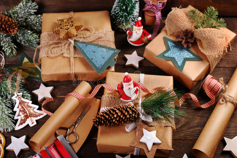 Preparing christmas gifts in rustic style. Christmas gifts in rustic style ,decorations and accessories on wooden background royalty free stock photos