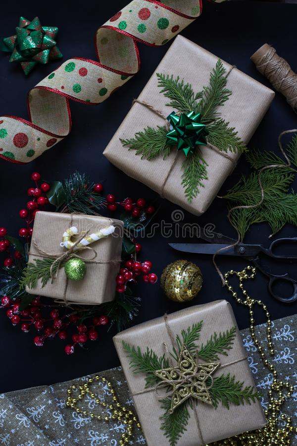 Preparing Christmas or New Year presents. Handmade wrapped gifts. stock images