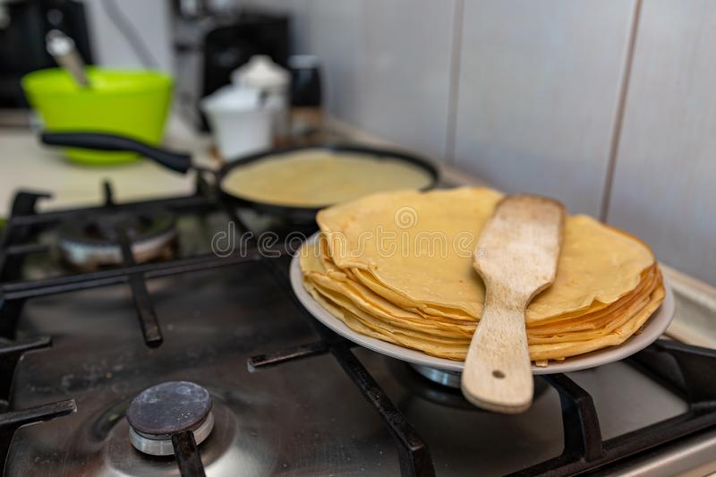 Preparing delicious pancakes on a home kitchen. Delicious delicacies served for dinner at home. Lunchtime at home background batter breakfast closeup cook stock image
