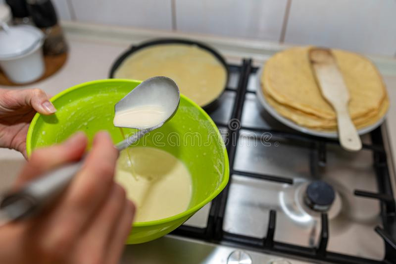 Preparing delicious pancakes on a home kitchen. Delicious delicacies served for dinner at home. Lunchtime at home background batter breakfast closeup cook stock photos