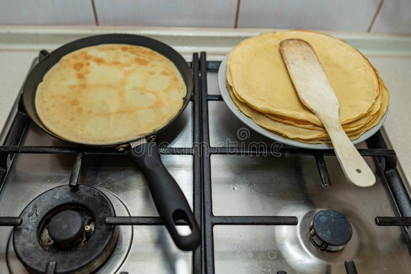 Preparing delicious pancakes on a home kitchen. Delicious delicacies served for dinner at home. Lunchtime at home background batter breakfast closeup cook royalty free stock photography