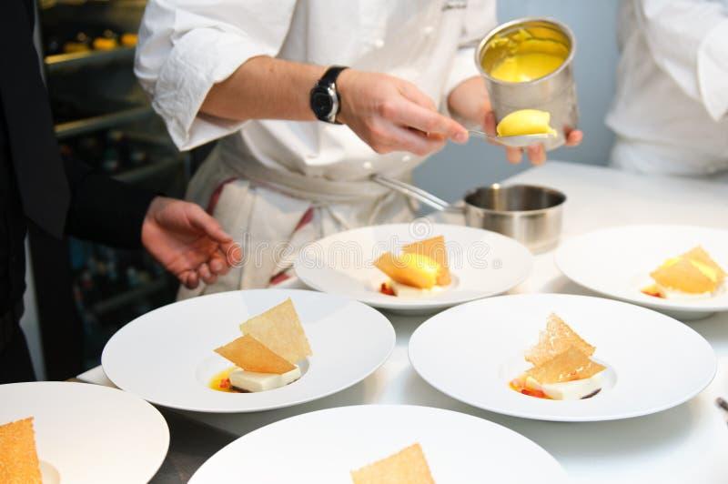 Preparing desserts for restaurant dinner stock photography
