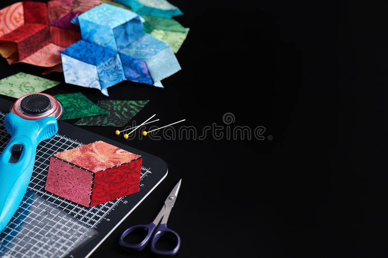 Preparing of diamond pieces of fabrics for sewing quilt, traditional patchwork, sewing and quilting accessories royalty free stock images