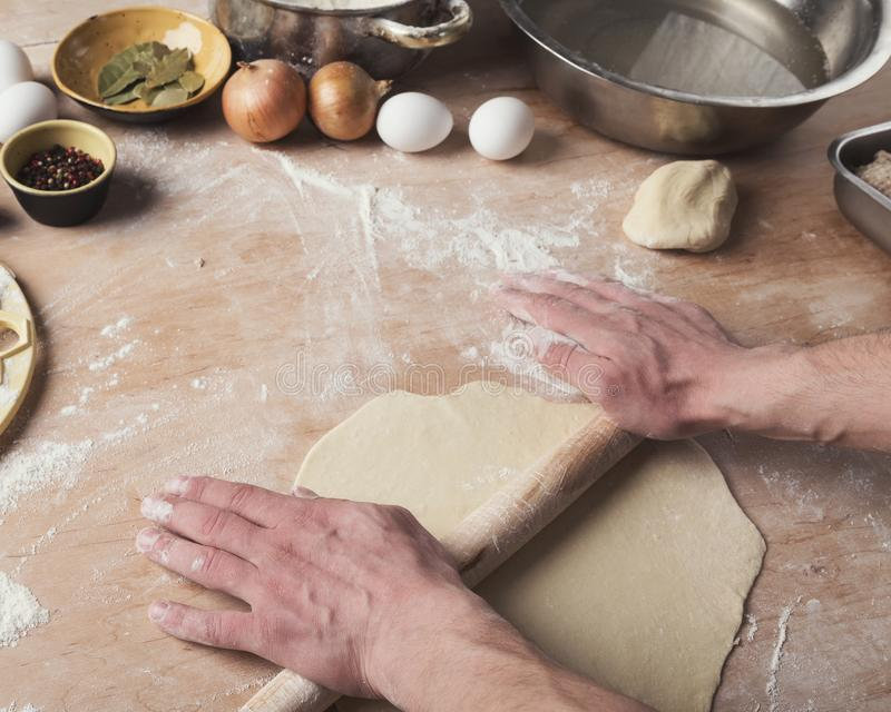 Preparing dumplings with meat, rolling out dough royalty free stock images