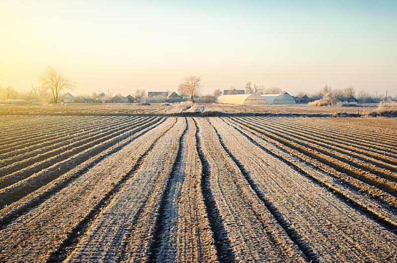 Preparing farm field for spring work and planting season. Choosing right time for sow fields plant seeds, protection from spring royalty free stock images