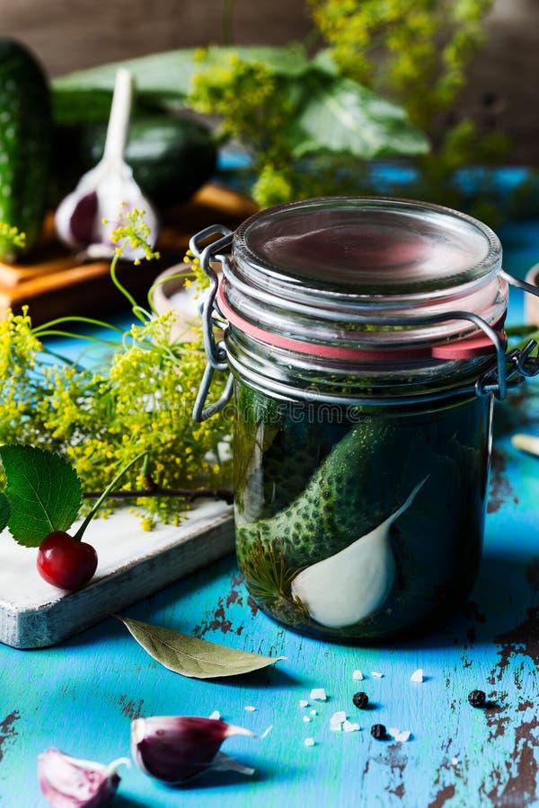 Preparing fermented and vegetarian preserved food, cucumbers royalty free stock photo