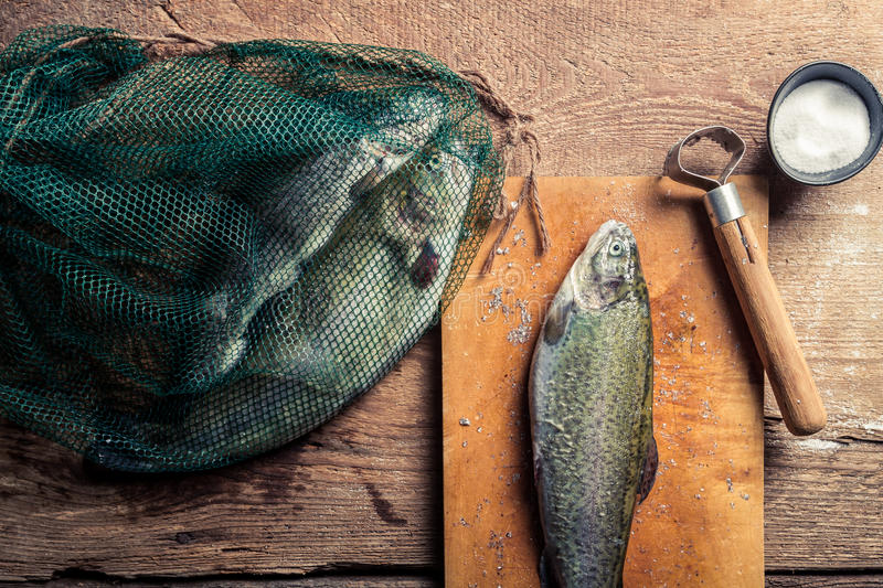 Preparing fish for dinner in the countryside royalty free stock photo