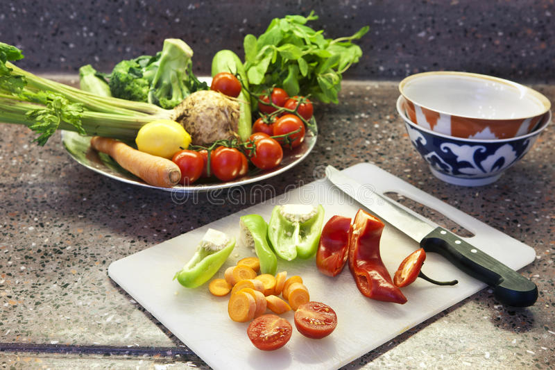 Preparing food. And vegetables for a salad royalty free stock photo