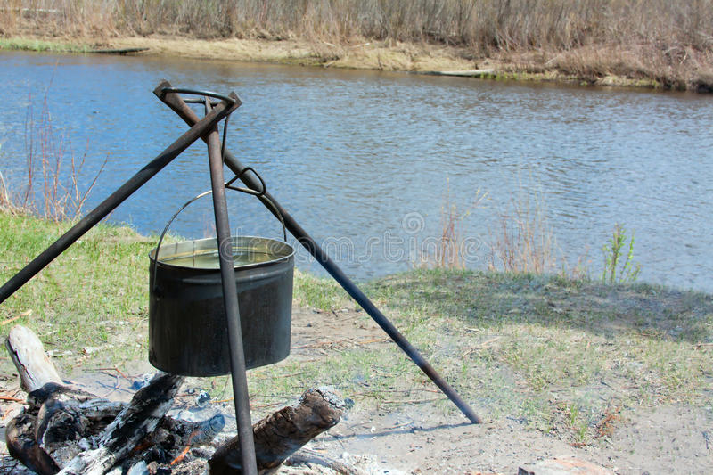 Download Preparing food on campfire stock photo. Image of pond - 19524440
