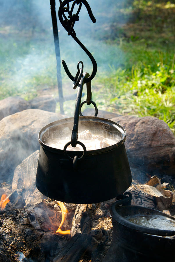 Download Preparing food on campfire stock image. Image of travel - 26074055